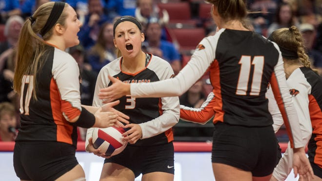 Hanna Hicks (3), coach Nancy Meyer and the Illini Bluffs volleyball team own three awards Thursday during the Best of Central Illinois Preps online award show. IB was the Female Team of the Year, Hicks was Female Athlete of the Year and Meyer the Coach of the Year.