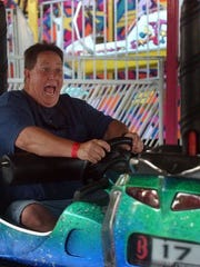 Scott Mayes of Simi Valley drives a bumper car with his son Trevor Mayes back in 2009 on the carnival's first day.
