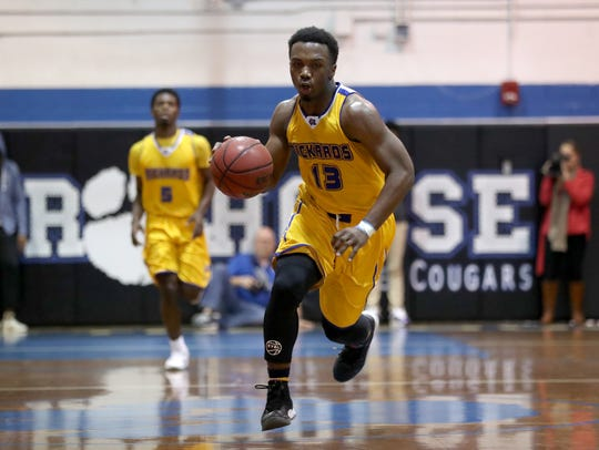 Rickards' Gentry Sparks brings the ball up court against
