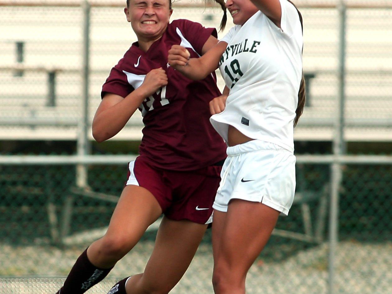 Morristown's Holly Burns, l, and Montville's Gianna Coppola vie for a header during their girls soccer matchup. September 9, 2015, Montville, NJ.