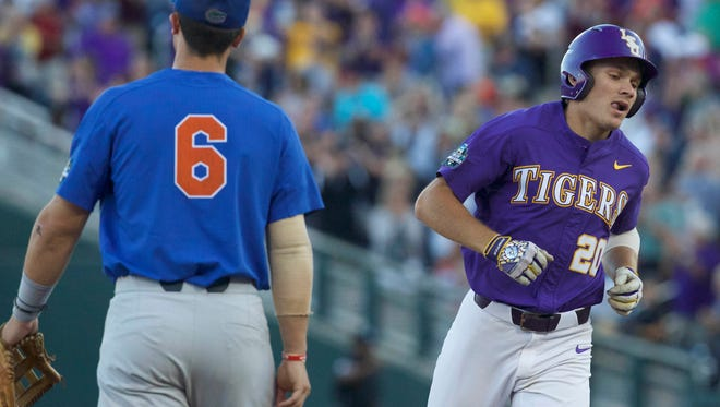 Jun 26, 2017; Omaha, NE, USA; LSU Tigers Antoine Duplantis (20) rounds the bases after hitting a home run against Florida Gators third baseman Jonathan India (6) in the sixth inning in game one of the championship series of the 2017 College World Series at TD Ameritrade Park Omaha. Mandatory Credit: Bruce Thorson-USA TODAY Sports