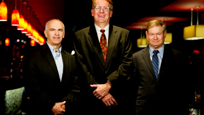 From left, Chris Chandler, chief financial officer for Radio Systems Corp., Jim Fritz, chief financial officer for Commercial & Investment Properties Co., and Michael Bachman, vice president of finance and administration for the Metropolitan Knoxville Airport Authority, pose for a photo during the Financial Executive of the Year awards dinner at the Holiday Inn World's Fair Park in Knoxville on Thursday, Nov. 16, 2017.