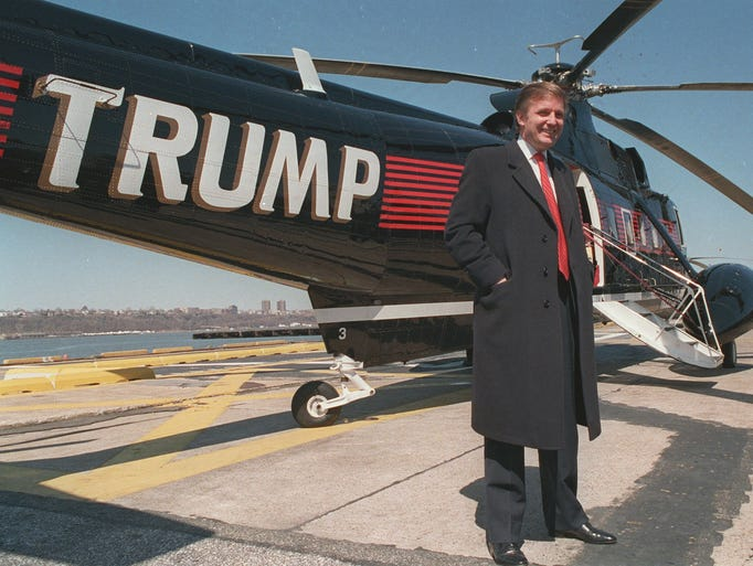 Donald Trump stands next to one of his three Sikorsky helicopters at ...