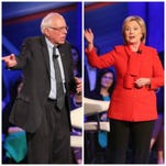 Bernie Sanders (left) and Hillary Clinton at the CNN Democratic Town Hall on Monday, January 25, 2016.