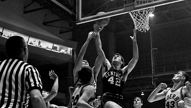 Kentucky's Pat Riley (42) goes for the rebound against Vanderbilt on Feb. 2, 1966.