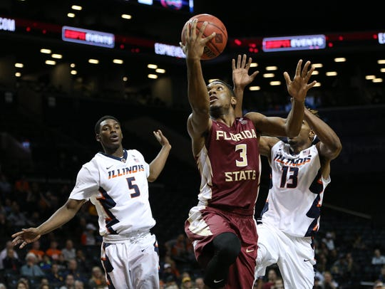 Florida State Seminoles guard Trent Forrest (3) shoots