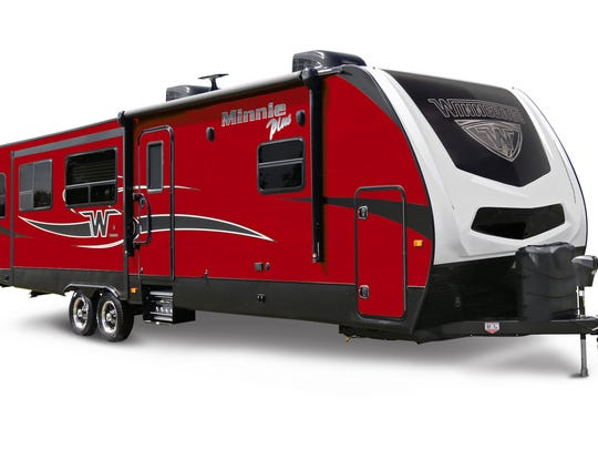 A Winnebago Minnie Plus towable travel trailer is pictured
