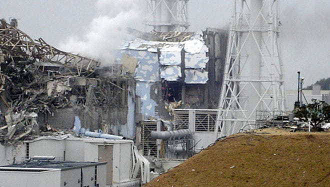 This image shows the damaged No. 4 unit of the Fukushima Dai-ichi nuclear complex in Okumamachi, northeastern Japan, on Tuesday March 15, 2011. White smoke billows from the No. 3 unit.