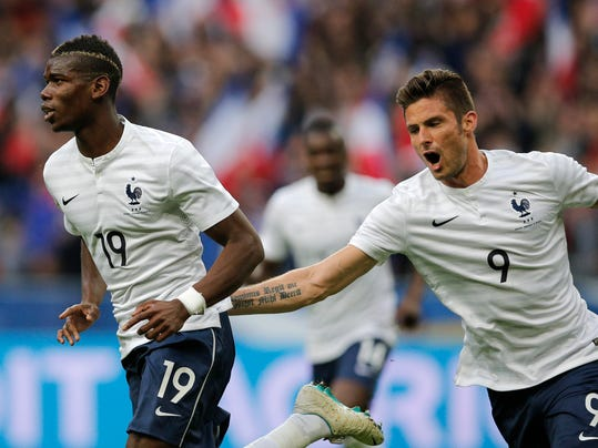 Paul Pogba of France, left, and Olivier Giroud celebrate a goal during the friendly soccer match between France and Norway at the Stade de France stadium in Saint Denis, outside Paris, Tuesday, May 27, 2014. France are preparing for the upcoming soccer World Cup in Brazil starting on 12 June. (AP Photo/Christophe Ena)