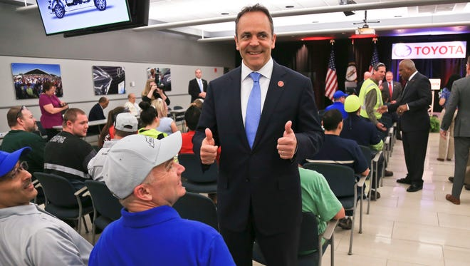 Kentucky governor Matt Bevin gives a thumbs-up before helping Toyota make a public announcement of the Japanese company's $1.33 billion in investment of the Georgetown plant April 10, 2017. It's the largest investment ever for the plant, which employs 8.200 people.