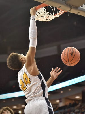 Moeller's Jeremiah Davenport with a one hand slam dunk in the third quarter of the State Championship game against Solon Saturday, March 24th at Value City Arena