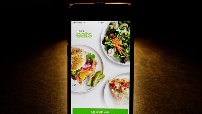 This Tuesday, Feb. 20, 2018, photo so the Uber Eats app on an iPhone in Chicago. More fast-food companies have been offering delivery by teaming up with food ordering apps.