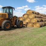 Donated hay being divided among Northern Plains ranchers