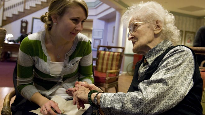 Sarah Baczagives a manicure to 86-year-old Vera Yuschak, a resident at a Sunrise Senior Living facility in West Chester, PA.