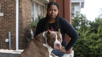 Siara Sellers, 28, of Detroit, says she can't afford to pay back $13,000 in federal student loans. She took out the loans while taking nursing courses at Henry Ford Community College for two semesters. Sellers, who now works part-time at UPS as a package handler, poses for a photo at her home with her 18-month old puppy Bo.