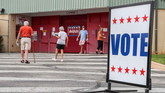 People vote Wednesday at the Toney Burger Center. Travis County Clerk Dana DeBeauvoir says turnout has been high compared with previous runoff elections.