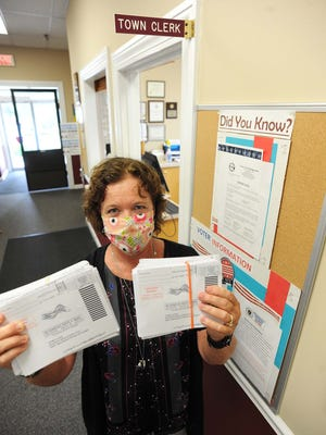 West Bridgewater Town Clerk Anne Iannitelli holds mail-in ballot applications on Wednesday, July 22, 2020 at the Town Hall.