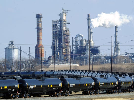 Train cars sit outside the Delaware City Refinery in 2013.