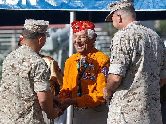 Former United States Marine and Navajo Code Talker Roy Hawthorne, center, talks with Marines including Major Gen. Daniel O'Donohue, right, at a ceremony in September honoring the Navajo Code Talkers and their contributions to the American war effort in World War II at Camp Pendleton, Calif. Hawthorne recalls his time served during World War II with pride, effortlessly sharing his native Navajo language as he shows off how he used codes to trick the Japanese.