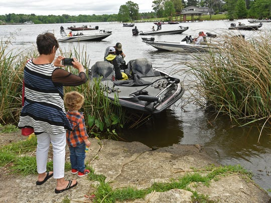 Boats return from a day of fishing at The Times All-City Bass Tournament held Saturday at Shreveport's Cross Lake.