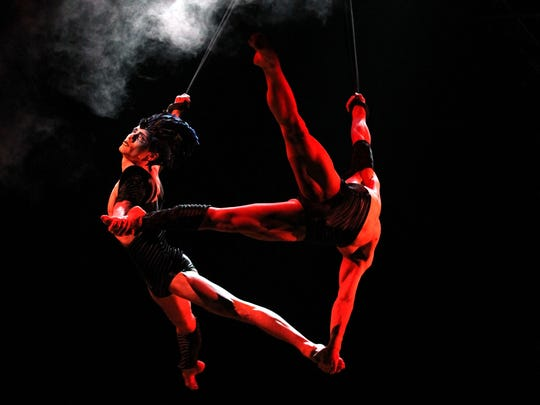 """Acrobats of Cirque du Soleil perform during a rehearsal of the show """"Varekai"""" in 2010 in Munich, Germany."""