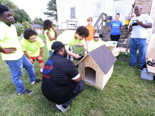 The members of the Young Lions build one of the houses during The Young Lions Dog House build at Trinity Tabernacle Church and Comminity Center in Salisbury Sunday, Sept. 17, 2017. The youth group sponsored by Labyrinth 807 Masonic Lodge of Salisbury, were on their way to building 15 dog houses with donated material by Lowe's of Salisbury and The Roofing Center. (Photo by Todd Dudek for The Daily Times)