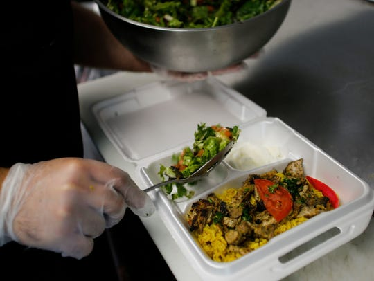 Chicken shawarma over rice served with a house salad