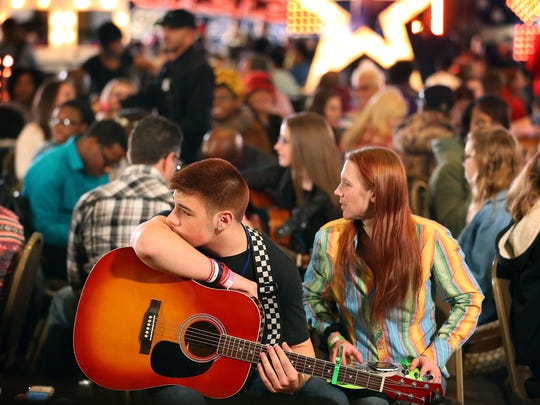 "Hunter Winders (left) from West Memphis, Arkansas, watches the competition with his mother, Whitney Winders, as he waits with other would-be stars to audition for ""America's Got Talent"" at the Cook Convention Center. The reality show ran an open casting call in Memphis as the ninth stop on a 10-city tour."