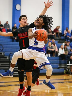 Lake View's Ahmad Daniels jumps to throw the ball as Ballinger's Kenyan Gonzales tries to block Friday, Jan. 5, 2018, at Lake View's Ben Norton Gym.