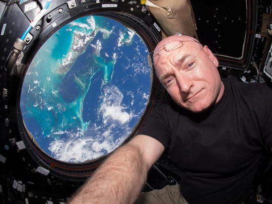 U.S. astronaut Scott Kelly floats inside the Cupola, a European Space Agency-built observatory module of the International Space Station providing a 360-degree view of the Earth and the space station on July 12, 2015.