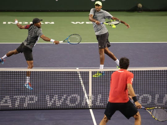 American Rajeev Ram, right, and South African Raven Klaasen at net against Marcelo Melo, of Brazil, bottom, and Lukasz Kubot, of Poland, in the BNP Paribas Open men's doubles finals on Saturday, March 18, 2017.