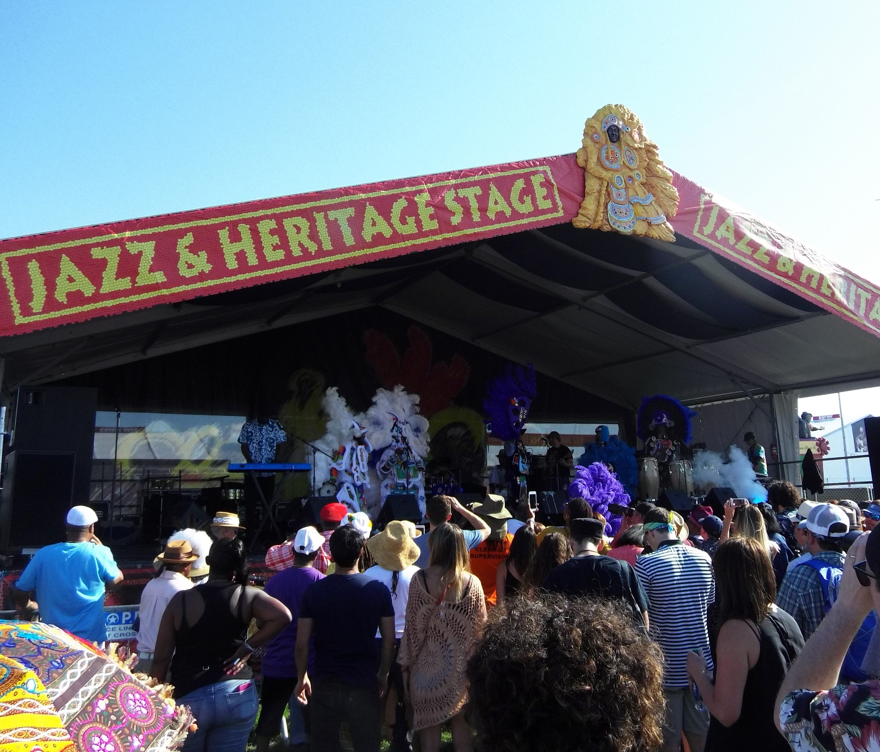 Music from the Jazz & Heritage Stage draws the crowds.