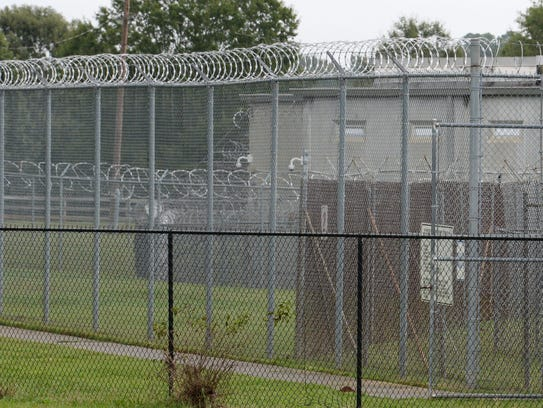 Gated and locked fences surround the Anderson County
