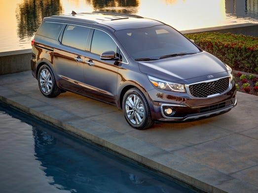 Kia Sedona retains a minivan's sliding side doors