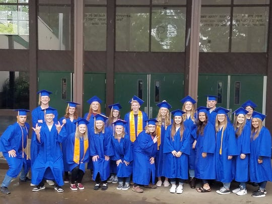 Stayton High School Class of 2017 graduates who hailed from Stayton Middle School pose for a photo on graduation day in front of their old haunt.