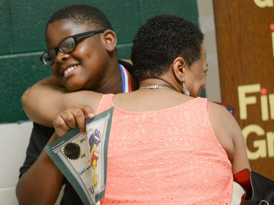 Joey Carr receives a hug from his grandma, Charlotte Jones, after he was awarded for most Accelerated Reader points Wednesday afternoon. Carr said he read about 45 books and earned 226 points.