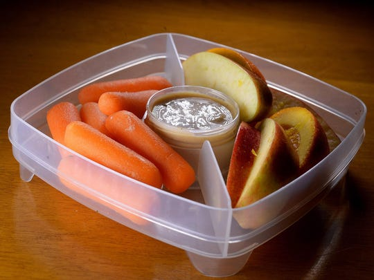 Salted tahini spread is an easy dip with carrots and apple slices. Oranges will keep the apples from turning brown too fast.