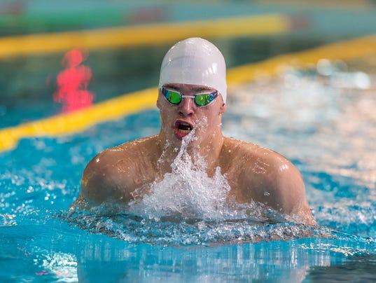 Male swimmer swimming
