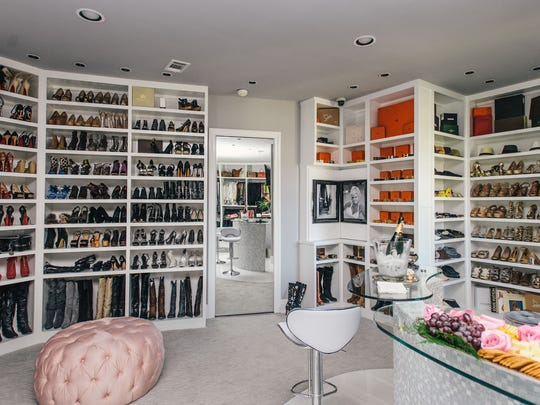 """In Theresa Roemer's """"she-cave,"""" you can relax at the Champagne bar while admiring the shoes."""
