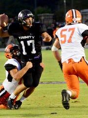 South Gibson's Connor Warren runs toward Trinity's
