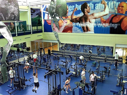 Sculptures hang from the ceiling over the weight room at Premier Health & Fitness Center.