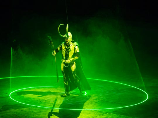 Loki stands in a circle of green light during the Marvel