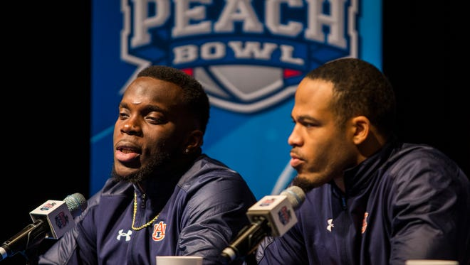 Auburn linebacker Deshaun Davis (left) and safety Tray Matthews (right) at a press conference at the Hyatt Regency Hotel on Friday, December 29, 2017, in Atlanta, GA. Auburn will face UCF in the Chick-fil-A Peach Bowl on January 1, 2018.