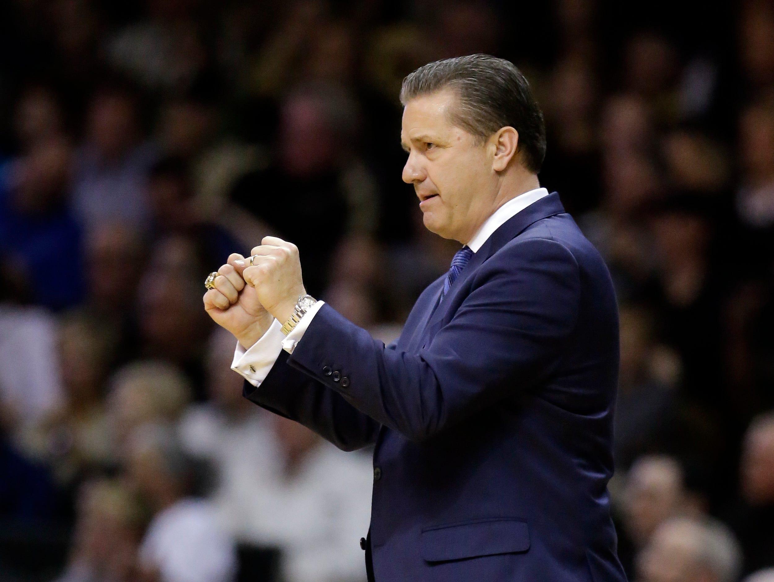 Kentucky head coach John Calipari gestures as he watches the action in the first half of an NCAA college basketball game against Vanderbilt Saturday, Feb. 27, 2016, in Nashville, Tenn. (AP Photo/Mark Humphrey)