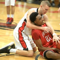 North Buncombe's Daniel Burchette, left, and Erwin's Malik Moore scrap for a loose ball on Jan. 15 in Weaverville.