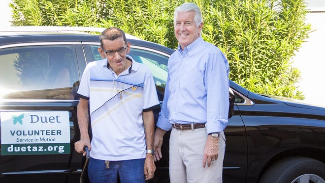Jon Allen, a volunteer with Duet, helps give rides to senior like Juan who can't drive.