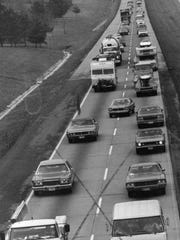 Vehicles drive down Interstate 40 West in 1975.