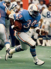 Earl Campbell looks for running room during his NFL