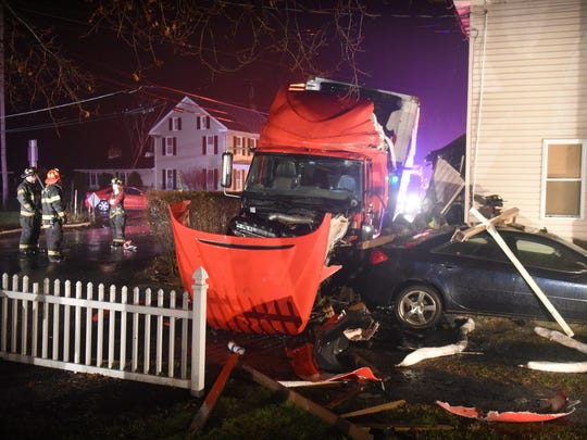 A tractor-trailer and a passenger vehicle collided at the intersection of N 934 and Black's Bridge Road in North Annville Township shortly before 11:00 p.m. Friday , Jan. 16. The driver of the car was treated at the scene for a head wound, neither driver was transported from the scene of the accident.The semi was headed north when it collided with the southbound passenger car. Supports from a utility pole and guide wires were ripped from their grounding, but no live wires were affected according to a PA State Police Officer at the scene. No one in the home was injured. State Police at the scene estimated Black's Bridge Road & N 934 would be closed at least an hour while the utility pole could be secured and the road cleared.