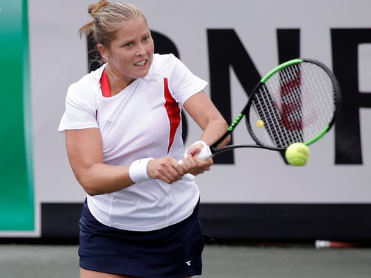 United States' Shelby Rogers returns a shot to Czech Republics's Katerina Siniakova during a Fed Cup semifinal tennis match, Saturday, April 22, 2017, in Wesley Chapel, Fla. (AP Photo/John Raoux)